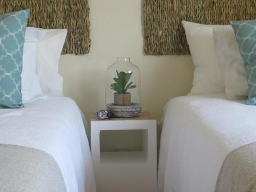 A bed or beds in a room at Apartamento Mar Salgado Ericeira