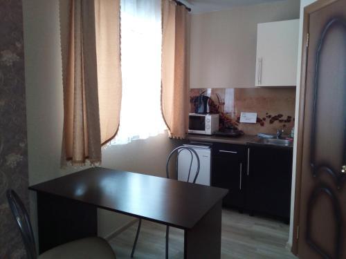 Кухня или мини-кухня в Apartment kak doma