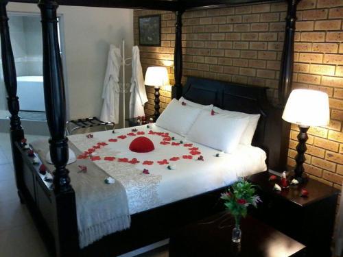 Кровать или кровати в номере Montana Boutique Guesthouse