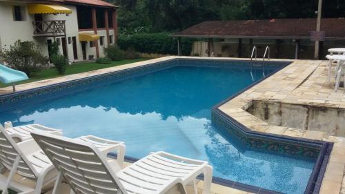 A piscina localizada em Abaete Pousada da Estancia ou nos arredores