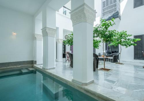 The swimming pool at or near Riad Sapphire