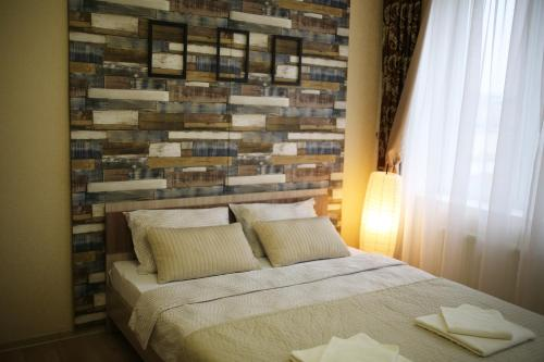 A bed or beds in a room at Apartment July on Nigmatullina 3