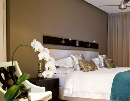 A bed or beds in a room at Atlantic Affair Boutique Hotel