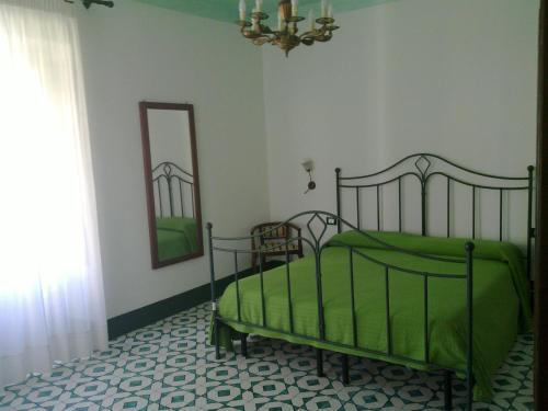 Letto o letti in una camera di Residence Acanto