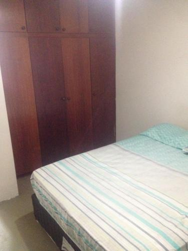 A bed or beds in a room at APTO CENTRAL COM WI-FI