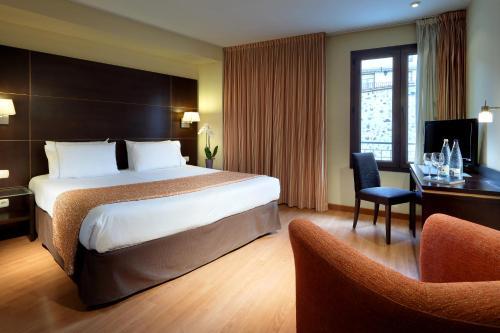 Cama o camas de una habitación en Eurostars Plaza Acueducto