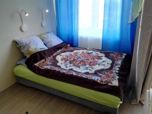 Кровать или кровати в номере Апартаменты на Цветочной 3