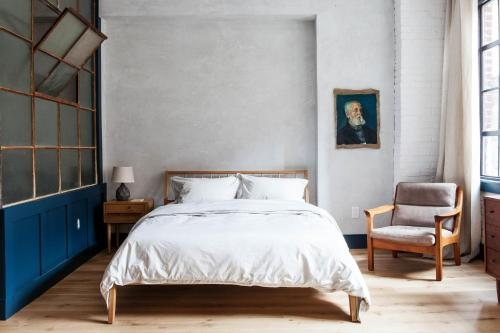 A bed or beds in a room at Lokal Hotel Old City