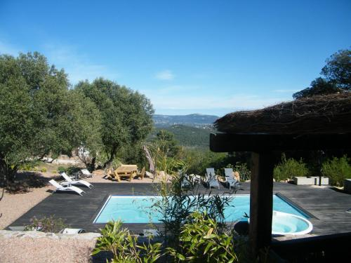 A view of the pool at Les Jardins de Mathieu or nearby