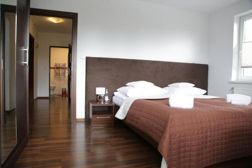 A bed or beds in a room at Noclegi Prestige