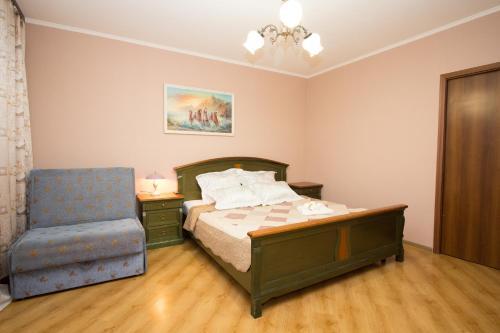 Кровать или кровати в номере Apartment on Kastanaevskaya