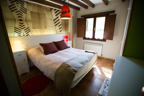 Cama o camas de una habitación en Casa Rural Andutza