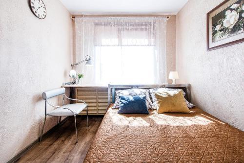 Кровать или кровати в номере Апартаменты Малая Охта