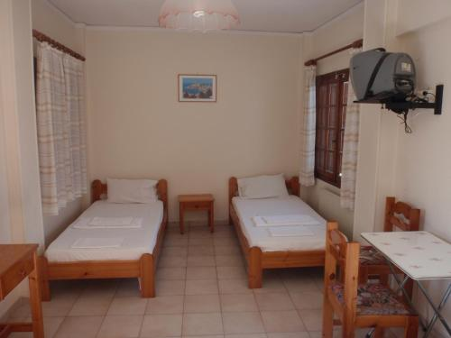 A bed or beds in a room at Vazakas Rooms