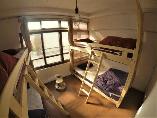 A bunk bed or bunk beds in a room at Yado Retro House Ginza Asahikawa