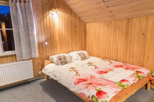 Voodi või voodid majutusasutuse Tuisuliiva Holiday House toas