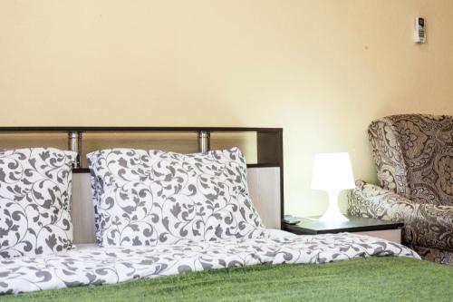 Кровать или кровати в номере Отель «На Лиговском»