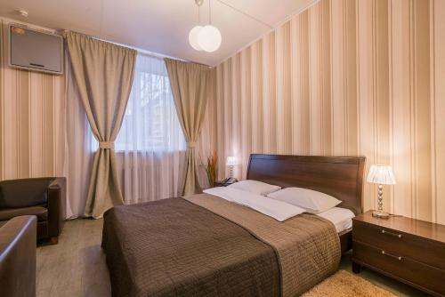 Кровать или кровати в номере Персона Мини Отель