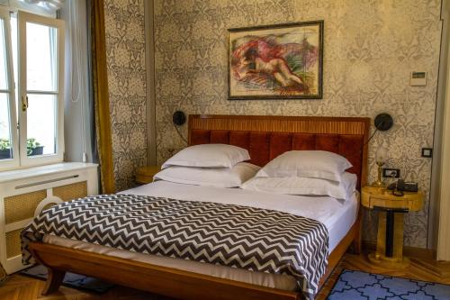 A bed or beds in a room at Vila Katharina
