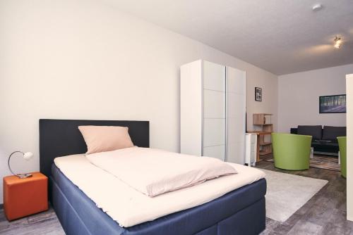 Ein Bett oder Betten in einem Zimmer der Unterkunft ai-Boardinghouse