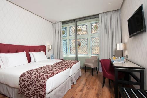 Cama o camas de una habitación en Eurostars Plaza Mayor