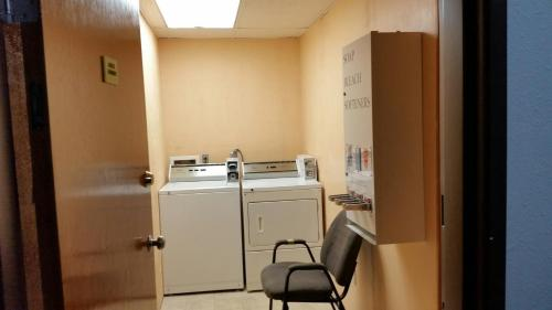 A kitchen or kitchenette at Super 8 by Wyndham Macomb