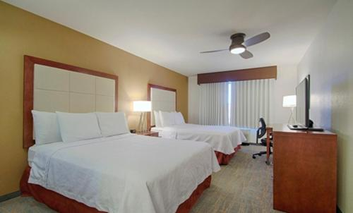 A bed or beds in a room at Homewood Suites by Hilton Las Vegas Airport