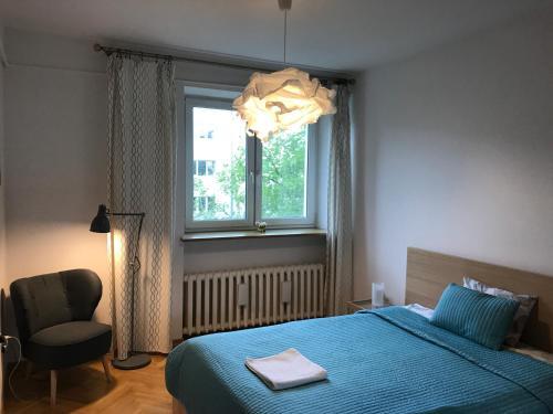 Łóżko lub łóżka w pokoju w obiekcie Wilson Apartment
