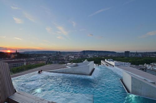 The swimming pool at or near B2 Boutique Hotel Zürich