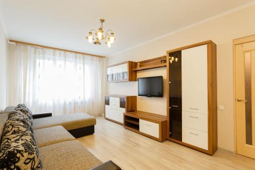A television and/or entertainment center at Business Brusnika Generala Antonova 4