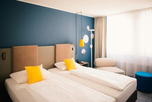 Cama o camas de una habitación en Vienna House Easy Trier