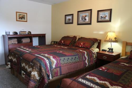 A bed or beds in a room at House on the Rock B&B