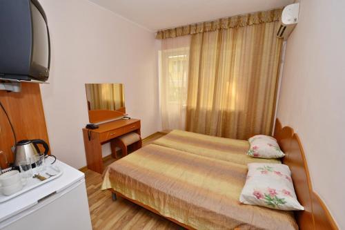 Кровать или кровати в номере Hotel Capitan
