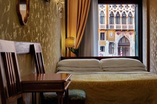 Letto o letti in una camera di Hotel Galleria