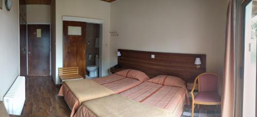A bed or beds in a room at Edelweiss Hotel