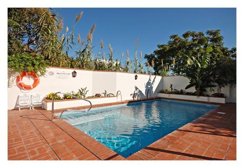 The swimming pool at or near Hostal La Posada