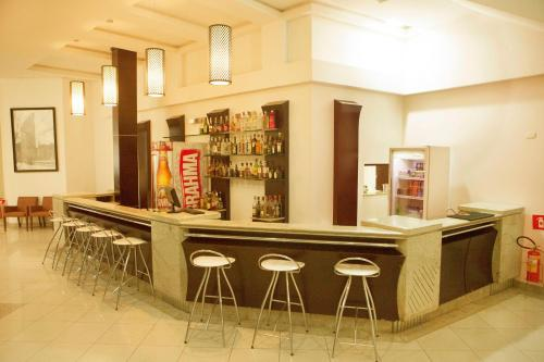 The lounge or bar area at Goldmen Hotel