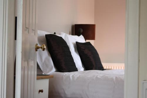 A bed or beds in a room at Creag Mhor Lodge