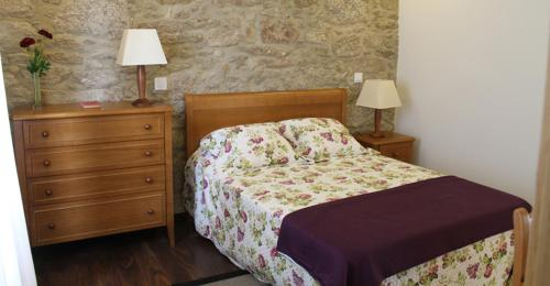A bed or beds in a room at Quinta Anna Horvath