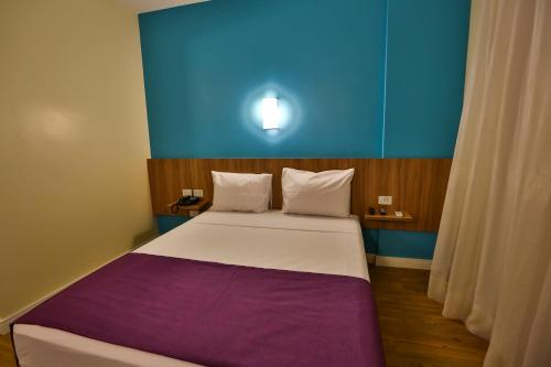 A bed or beds in a room at Go Inn Campinas