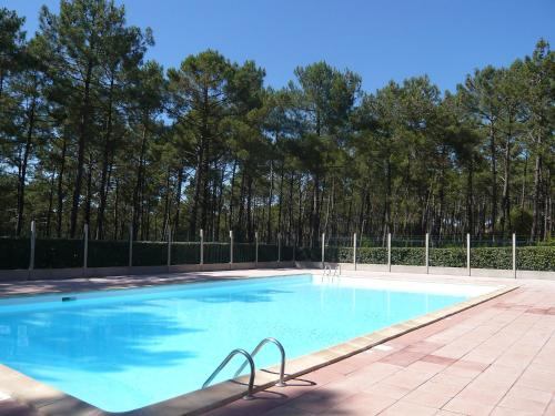 The swimming pool at or near Holiday Home Les Palombes-1