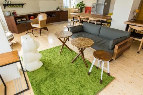 A seating area at Mr. Lobster's Secret Den design hostel