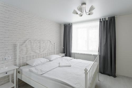 A bed or beds in a room at Хочу приехать на Кирова 38, 40, 55