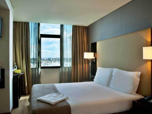 Cama o camas de una habitación en TURIM Alameda Hotel