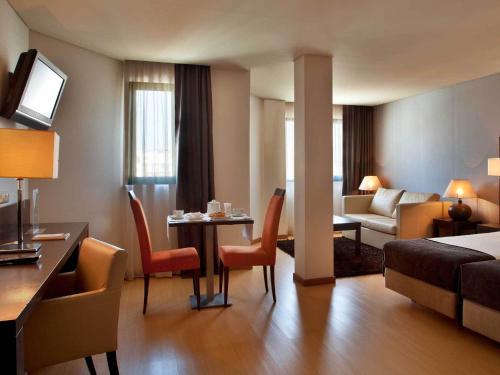 Uma área de estar em TURIM Iberia Hotel