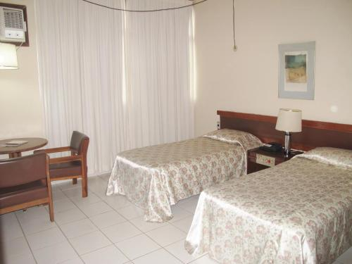 A bed or beds in a room at Hotel Vitoria Palace