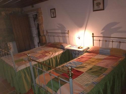 A bed or beds in a room at Casa da Vinha Velha