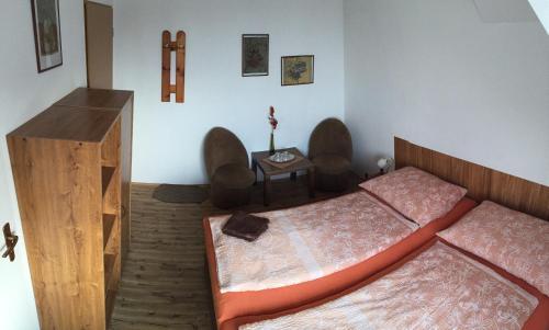 Postel nebo postele na pokoji v ubytování Penzion Rozkvet