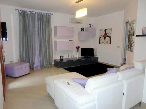 Area soggiorno di Casa vacanze Loredana