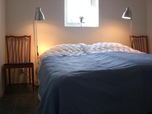 Säng eller sängar i ett rum på Ola-Nils Gård